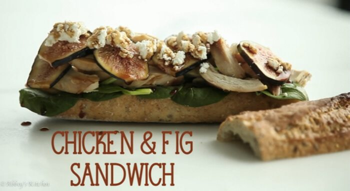 """A sandwich with text overlay \""""Chicken & Fig Sandwich.\"""""""