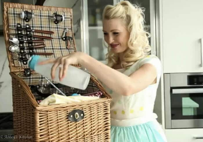 Abbey Sharp packing a picnic basket in a kitchen.
