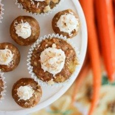 An overhead photo of multiple carrot cake cupcakes on a serving platter.