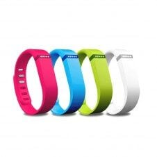 Four colourful fitbits.