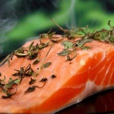 A close up of a slice of salmon before getting baked.