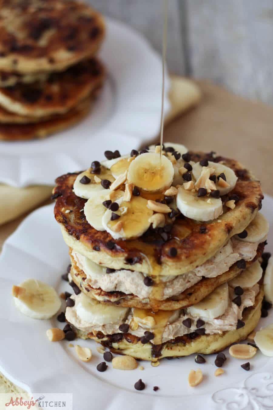 Banana protein pancakes with syrup drizzled over top.