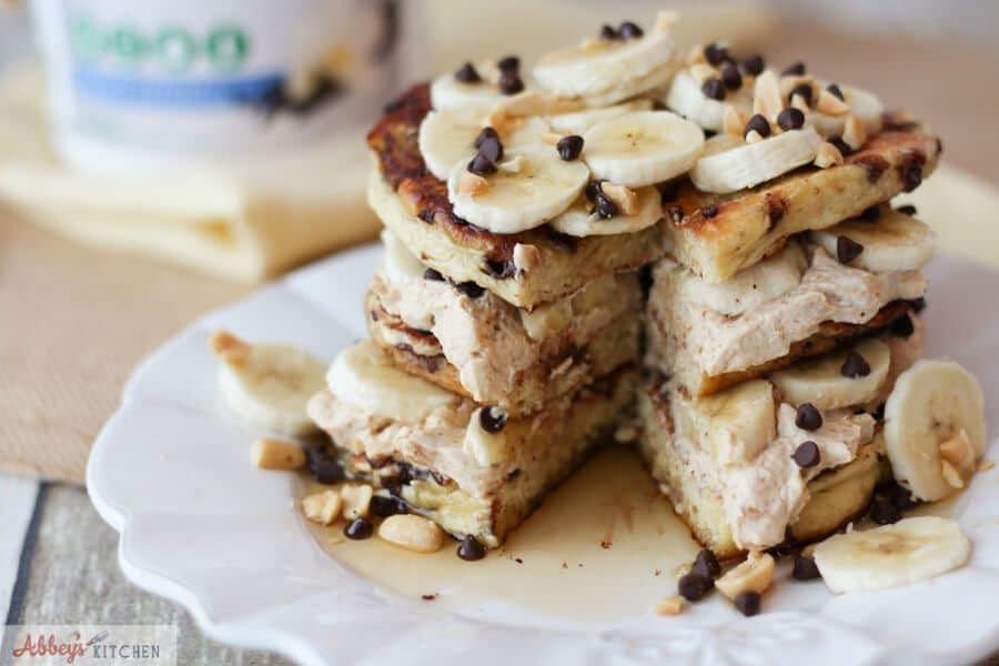 A stack of banana protein pancakes sliced opened.
