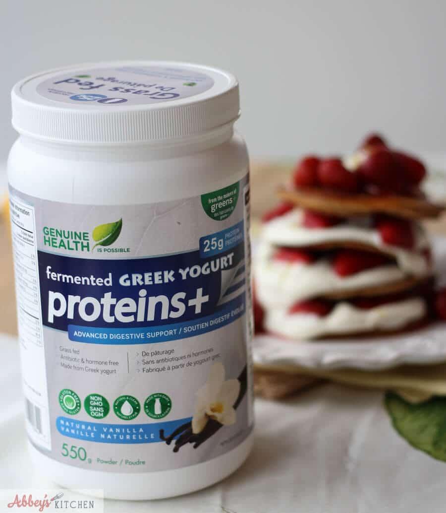 A bottle of Genuine Health protein powder.