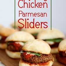 "A pinterest image of multiple sliders with the text overlay ""Healthy Chicken Parmesan Sliders."""