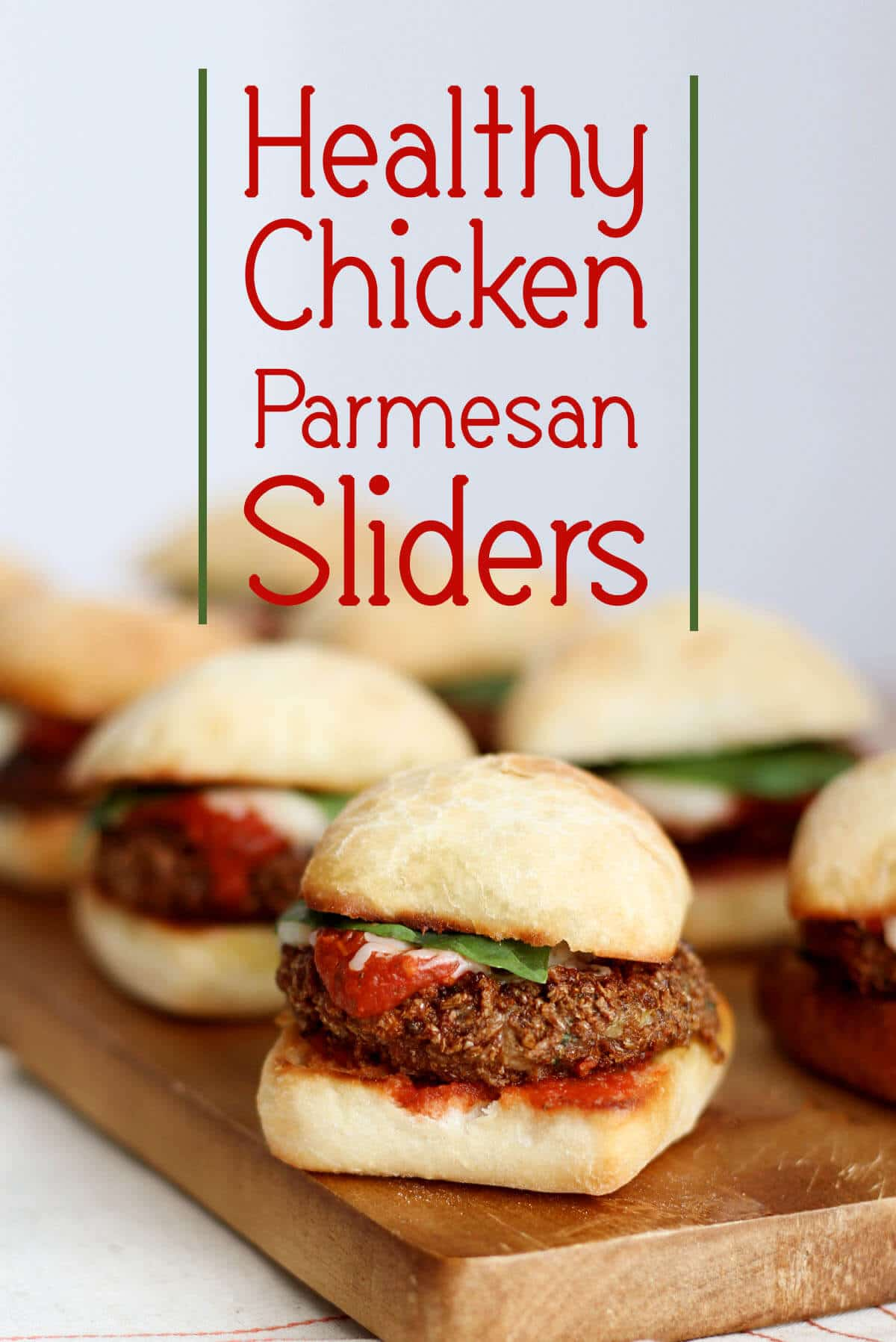 "A pinterest image of multiple sliders with the text overlay ""Healthy Chicken Parmesan Sliders.\"""