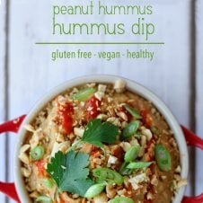 "A pinterest image of an overhead photo of dip in a red bowl with the text overlay ""THAI peanut hummus dip gluten free - vegan - healthy."""