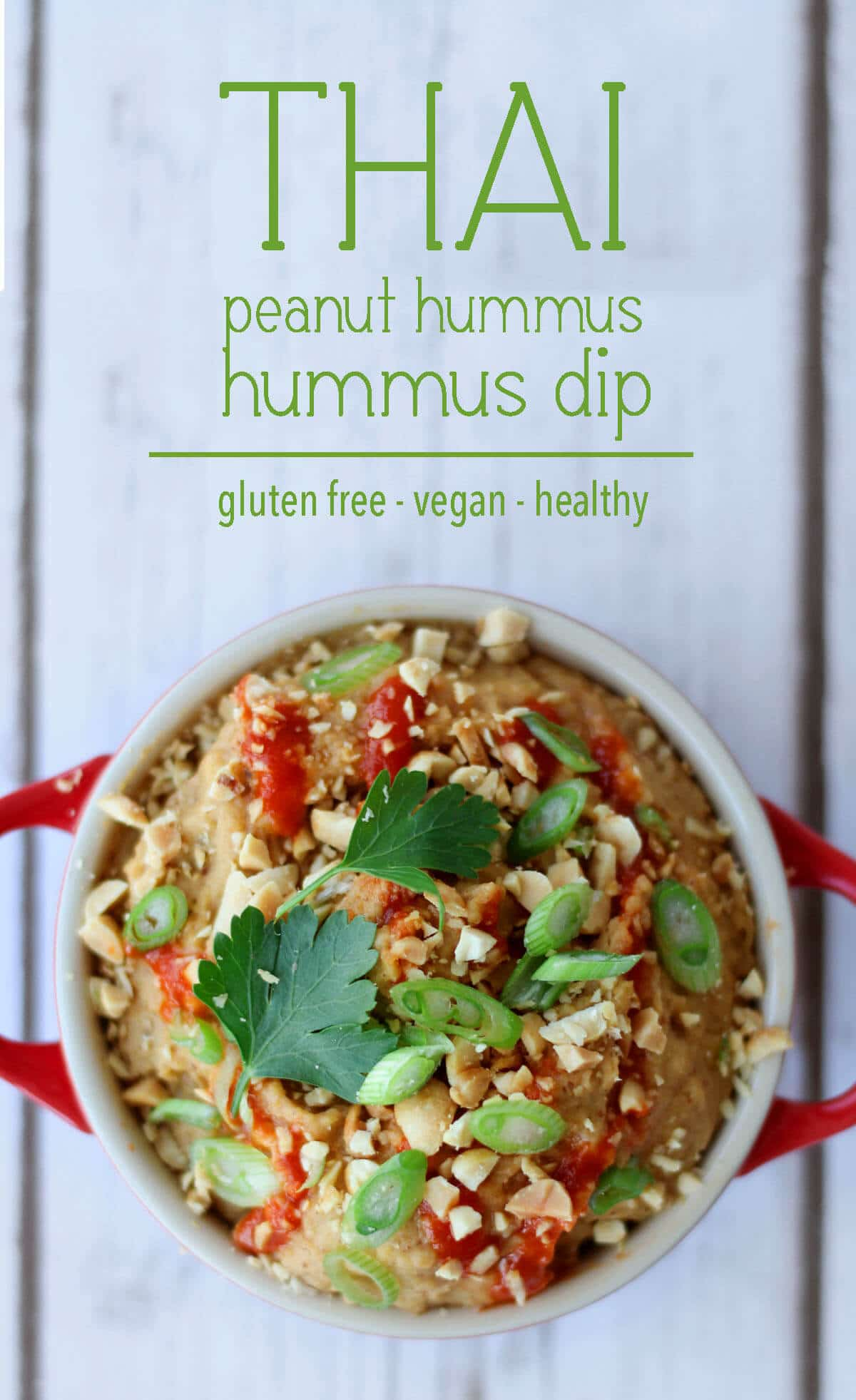 "A pinterest image of an overhead photo of dip in a red bowl with the text overlay ""THAI peanut hummus dip gluten free - vegan - healthy.\"""