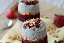 Two containers of peanut butter and jam vegan chia pudding.