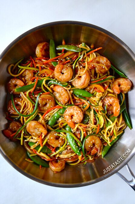 A wok with asian zucchini noodle stir fry with shrimp.