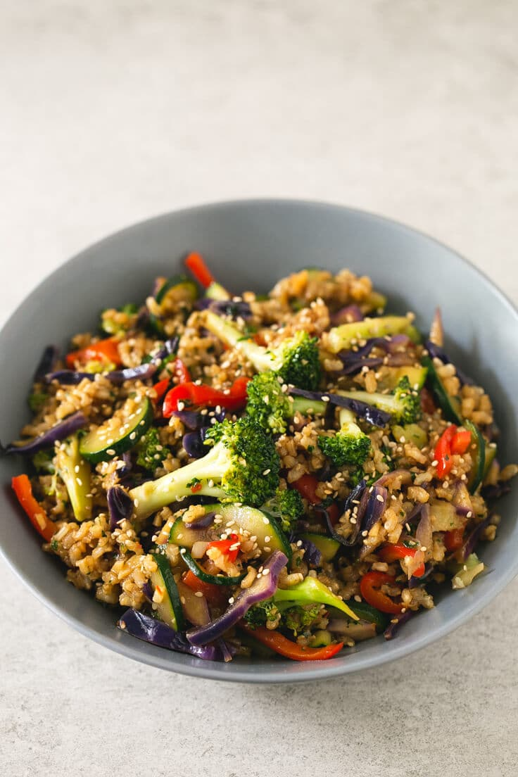 A whole of brown rice stir fry with vegetables.