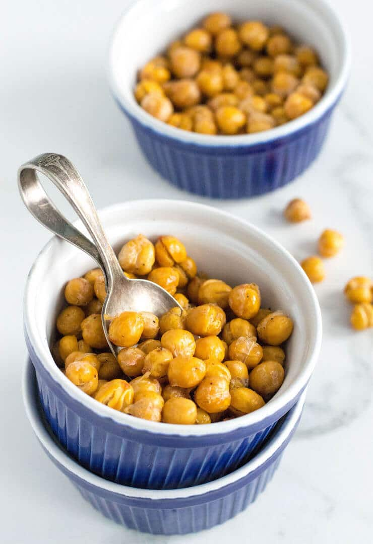 A small blue bowl of crispy chickpeas.