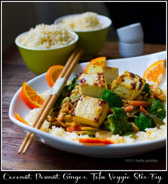 Photo of a bowl of rice with stir fry on top.
