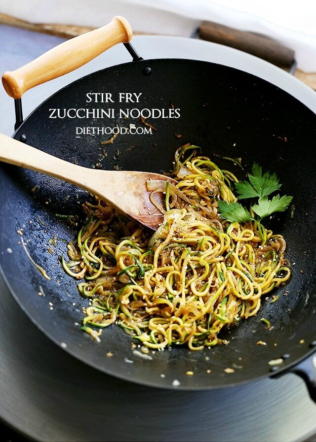 A wok with stir fry zucchini noodles.