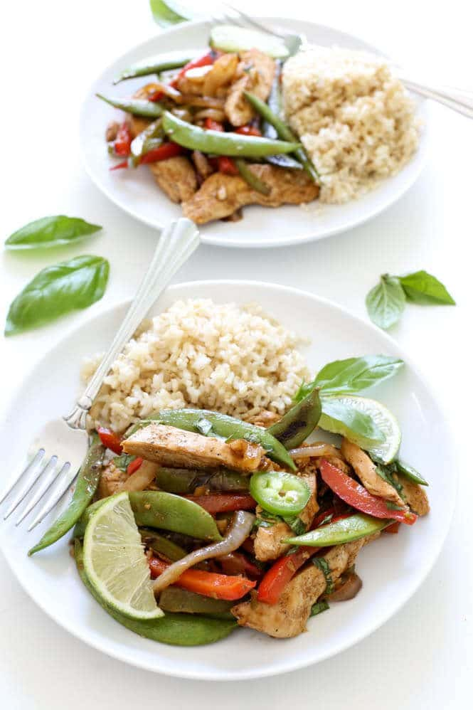 A plate of thai basil chicken stir fry.