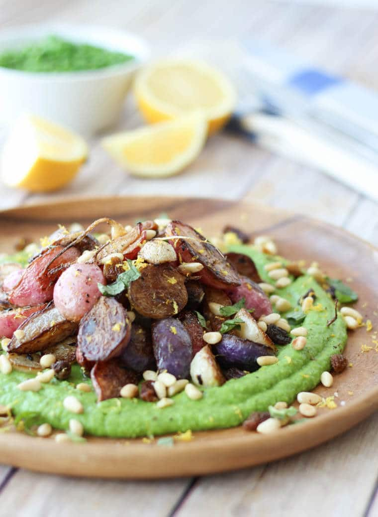 These Middle Eastern inspired za'atar roasted radishes with silky pea puree, golden raisins and pine nuts is a perfect side dish or shareable starter that's gluten free, vegan and dairy-free.