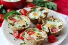 Caprese egg cups on a white plate.