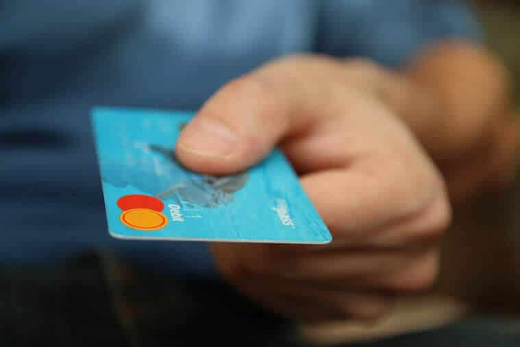 person holding a bank card