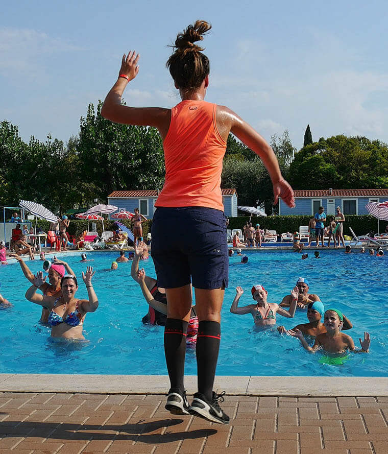 person leading a group exercise class in a pool