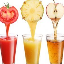 Glasses of juices with the fruit on top.