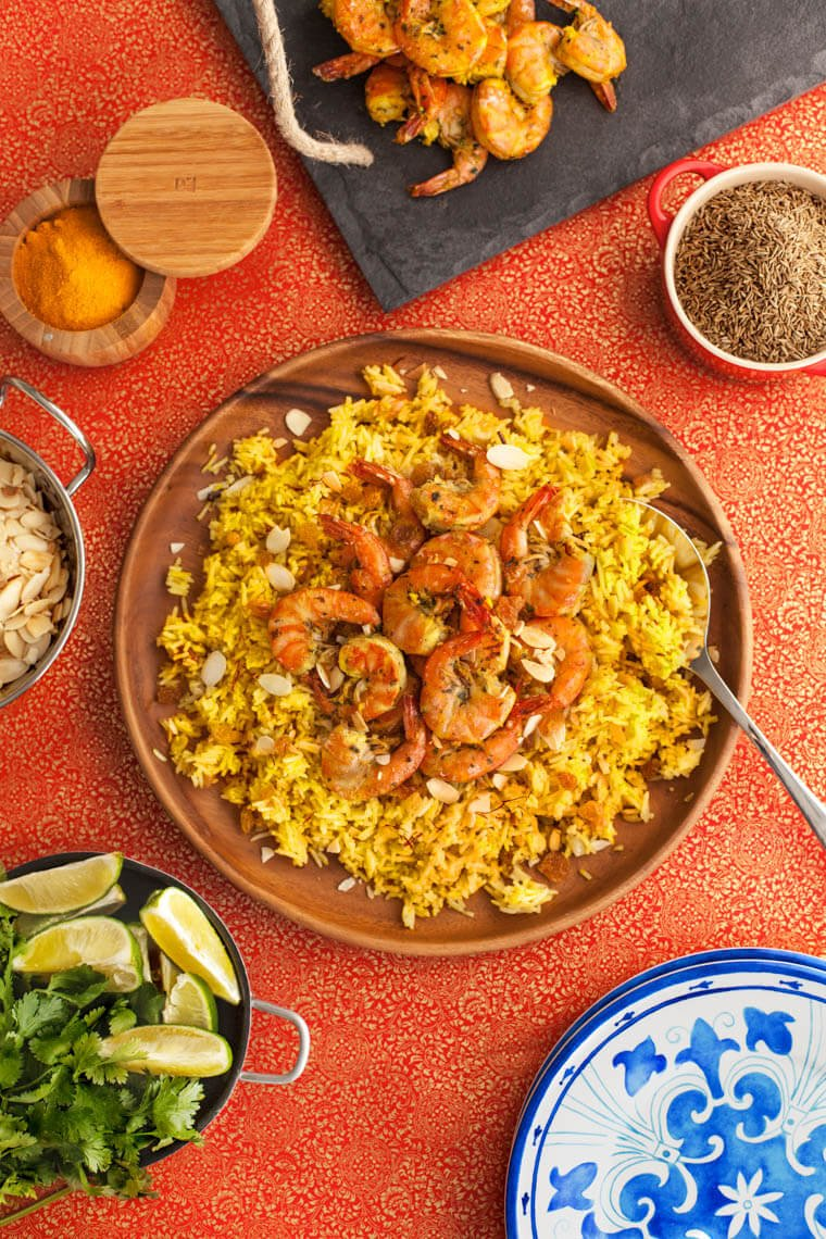This healthy gluten free shrimp Biryani recipe starts with a flavorful Indian Shrimp marinade and is served peel and eat style. It's so good, you won't want to stop licking your fingers.