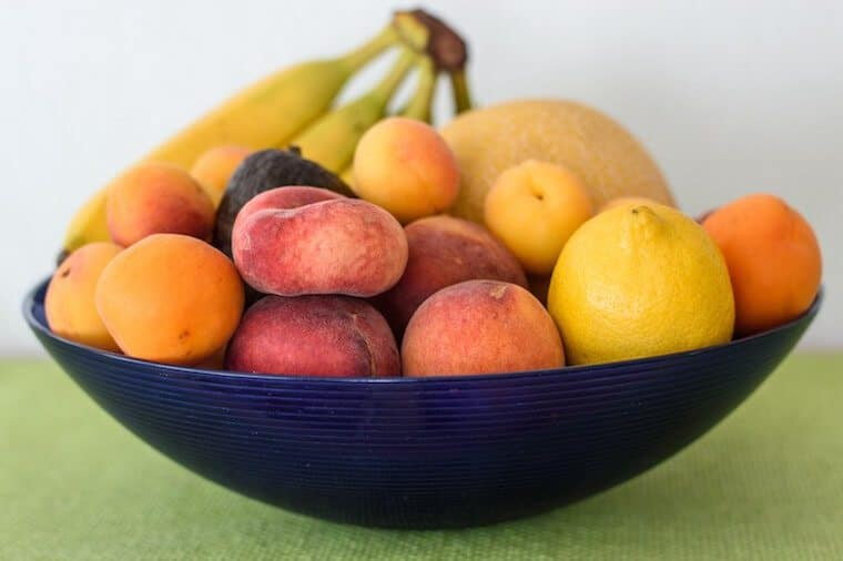 Blue bowl with fruit.