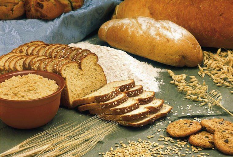 Sliced bread, flour and wheat.