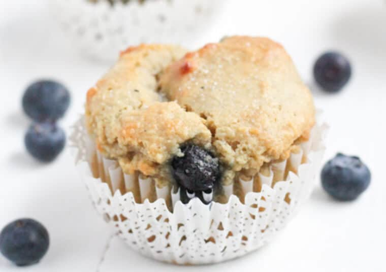 A close up of a gluten free blueberry muffin.
