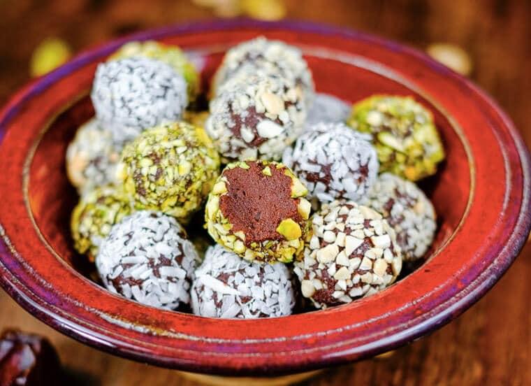 A bowl of luscious date avocado chocolate truffles.
