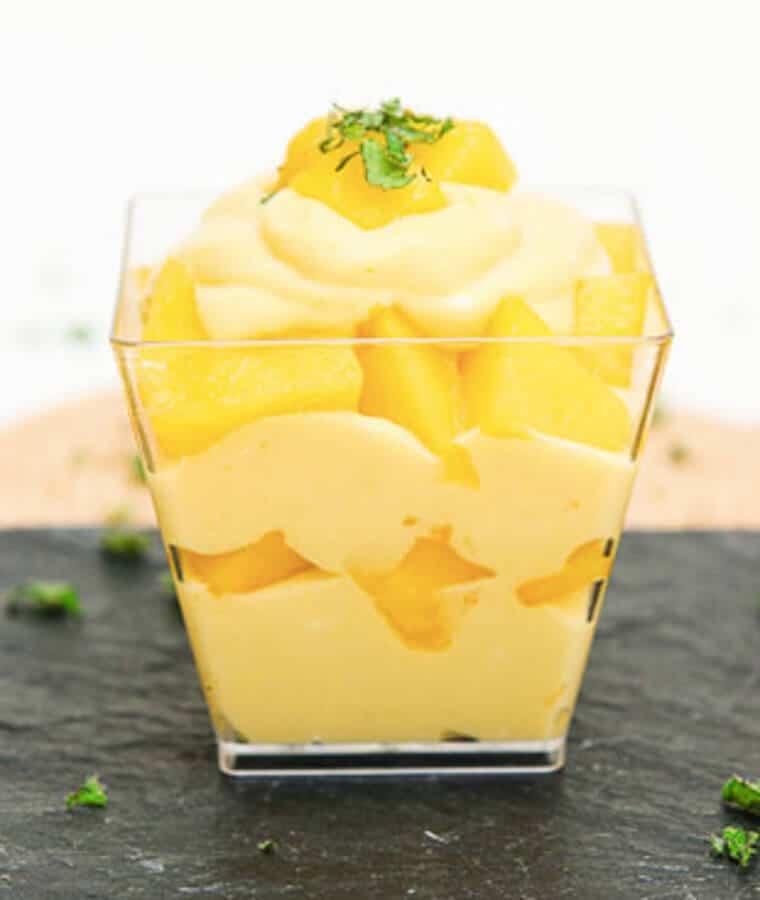 A cup of mango mousse parfait.