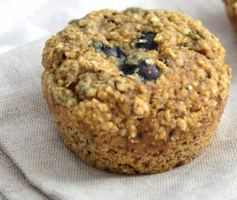 A close up of a blueberry quinoa muffin.