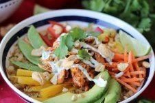 A bowl of paleo cauliflower rice chicken burrito bowl.
