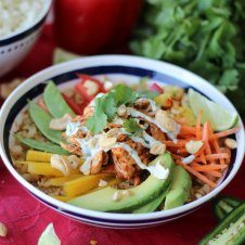 A bowl of paleo cauliflower rice chicken burrito bowl.