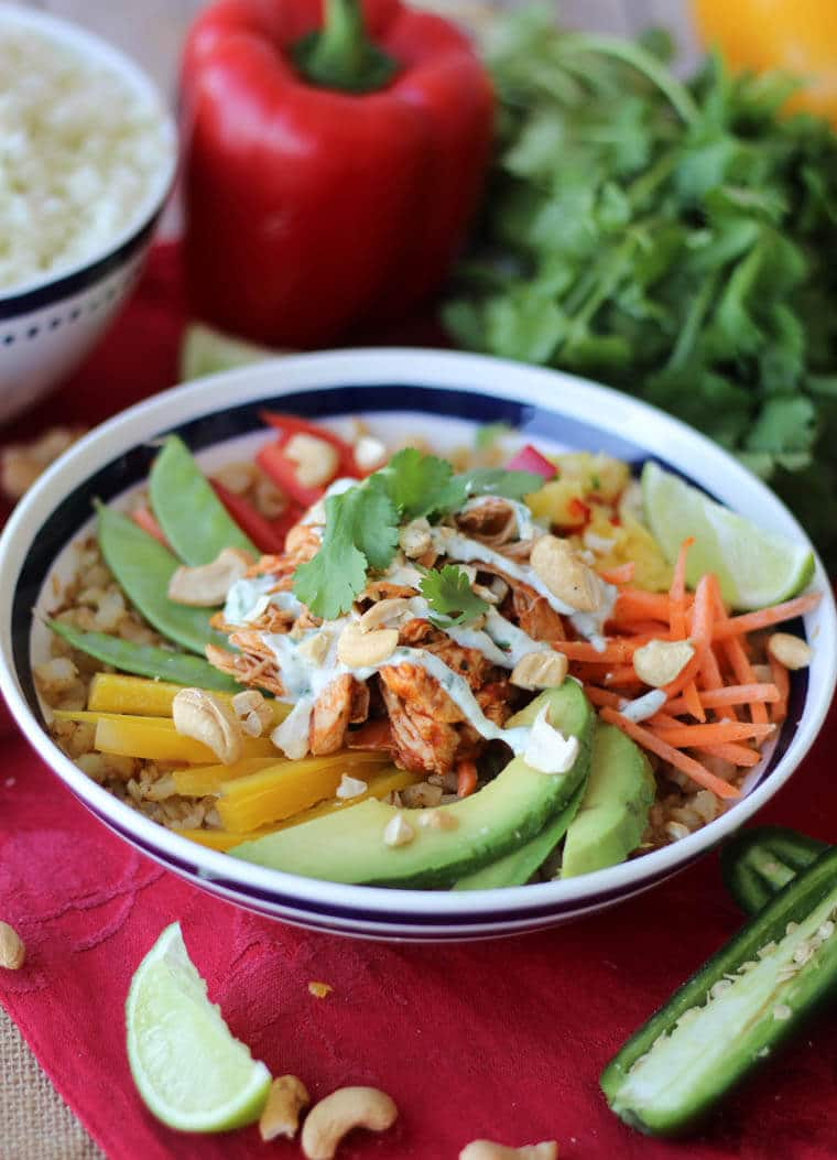 This Paleo Cauliflower Rice Chicken Burrito bowl with Dairy Free Cilantro Lime Crema is the perfect low carb, high protein, gluten free meal for refueling your body well.
