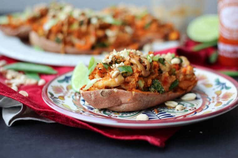 This Paleo Peanut Satay Stuffed Sweet Potatoes with Chicken is an easy gluten free dinner idea to get good food on the table fast!