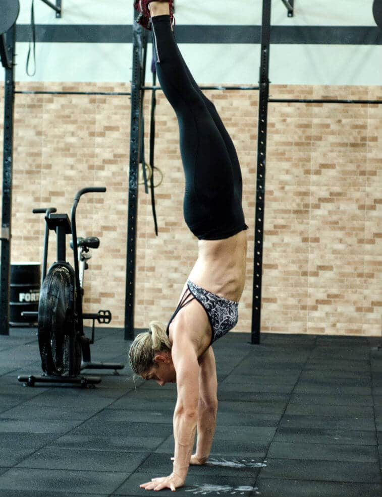 A person doing a handstand.