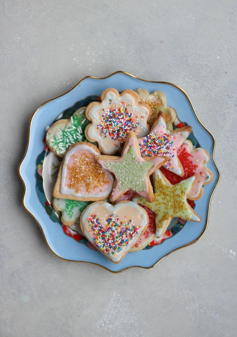 An overhead photo of a plate of multiple sugar cookies.