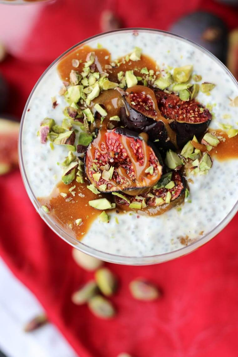 A close up overhead photo of a roasted fig chia pudding with tahini date caramel on top.
