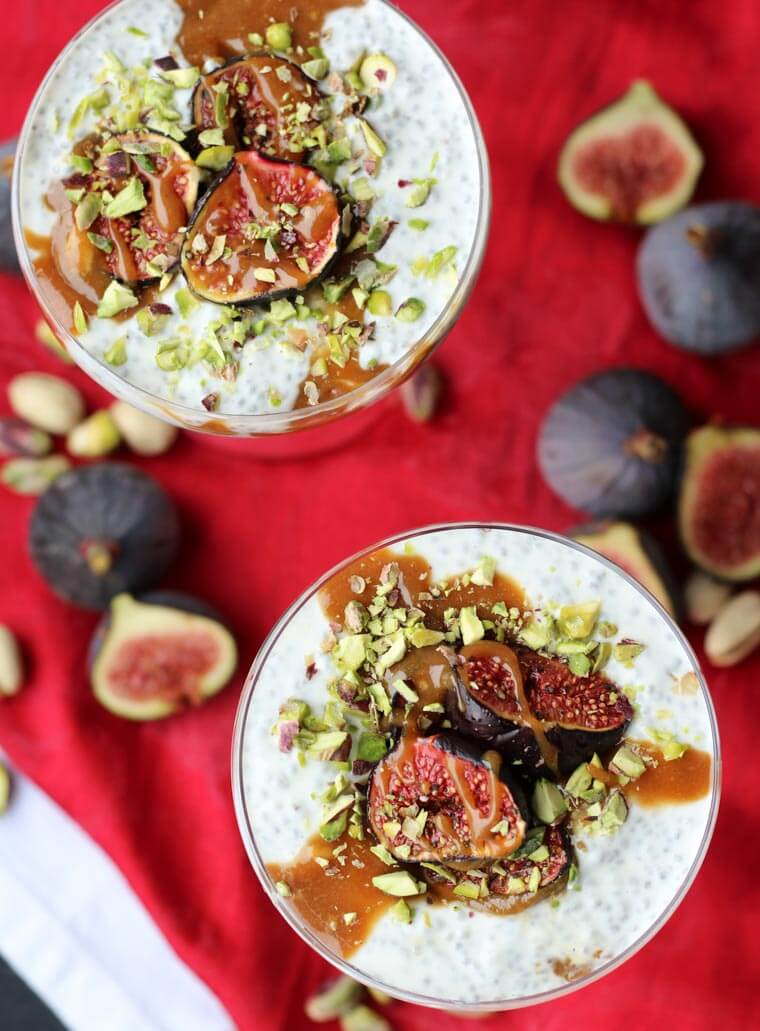 An overhead photo of two roasted fig chia pudding with tahini date caramel on top.