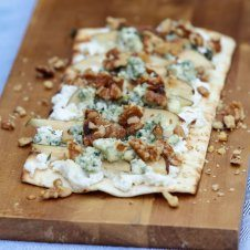 A tasty pear and blue cheese grilled pizza with ricotta, walnuts and thyme.