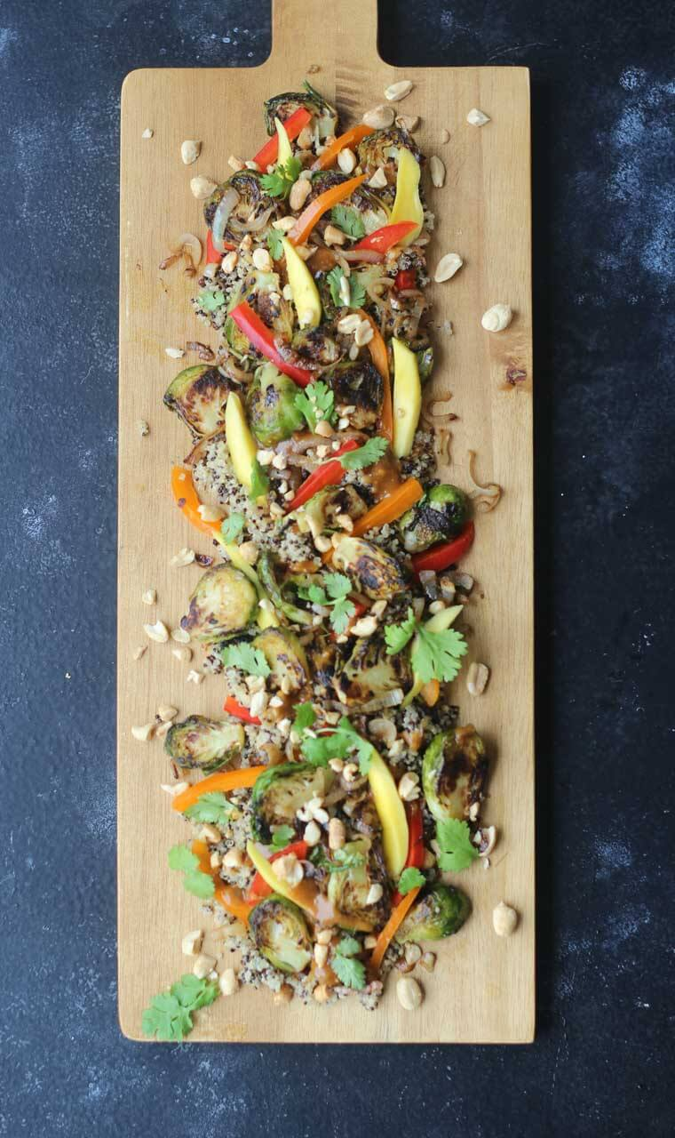 This recipe for Charred Brussels Sprout Salad with Pickled Mangos and Peanut Sauce is a crowd-pleasing favourite that's naturally gluten free, dairy free and vegan!