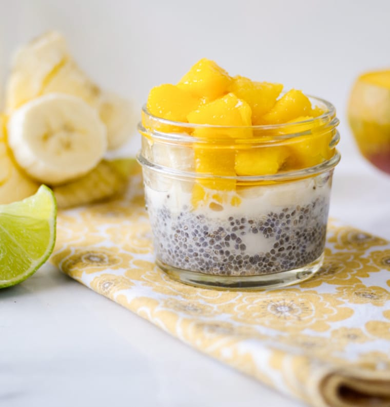 Chia pudding in small mason jar cup topped with chopped mango.