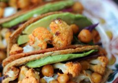 These vegan buffalo cauliflower and chickpea hard tacos are loaded with spicy buffalo flavour in buffalo-glazed hard tacos.