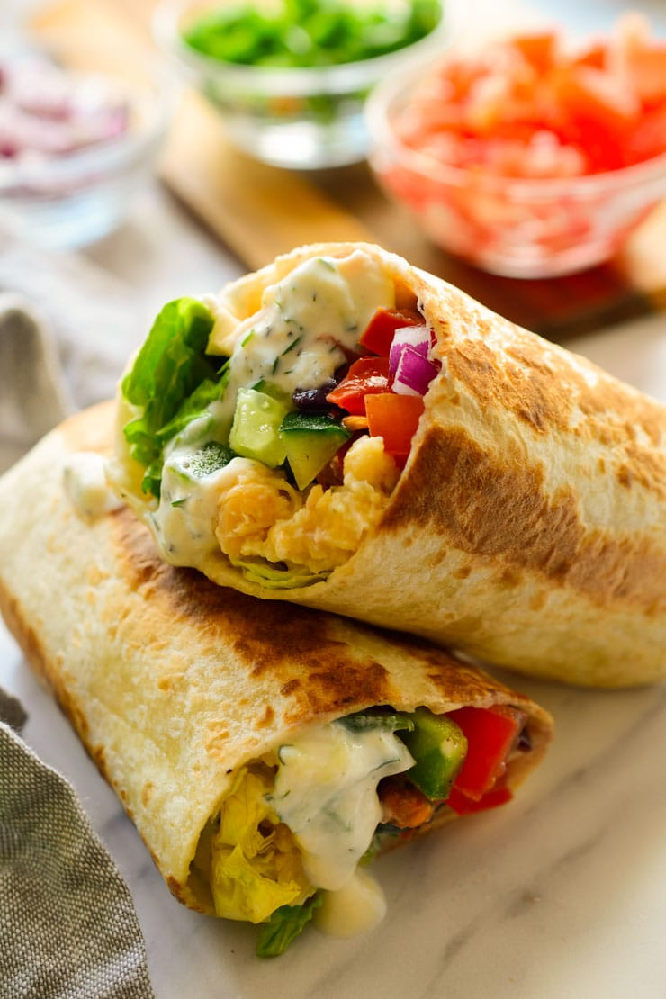 Two wraps filled with veggies.