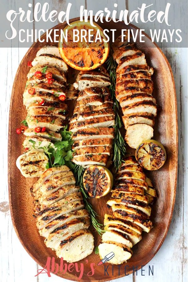 pinterest image of grilled marinated chicken breasts five ways on a wooden serving board with text overlay