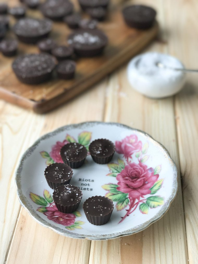 vegan gluten free tahini caramel chocolate cups on a floral plate