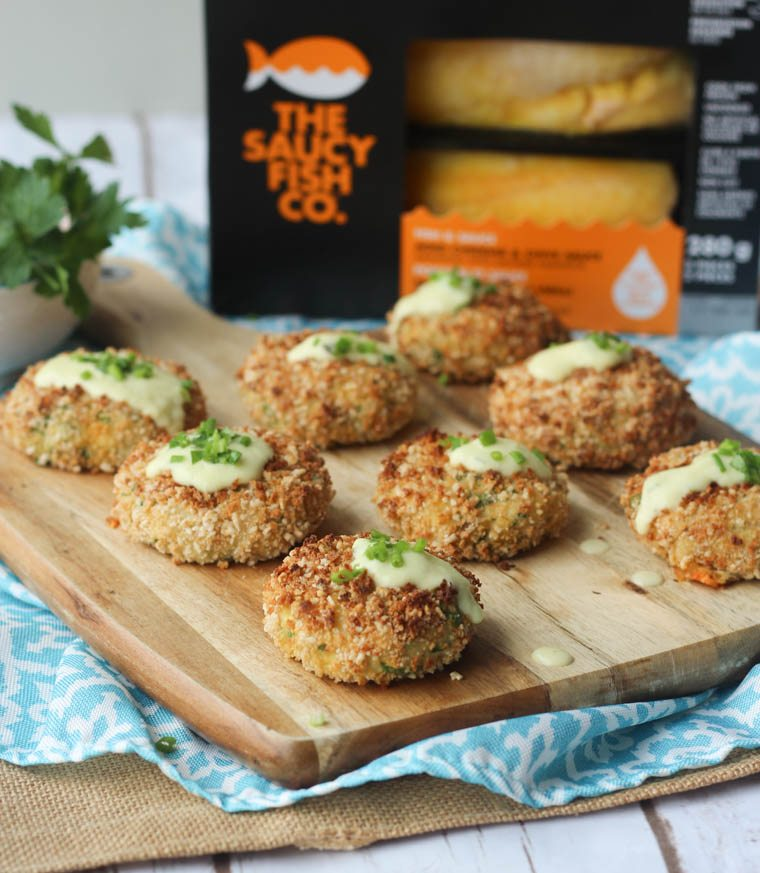 These gluten free cheese stuffed fish cakes with aged cheddar sauce will quickly become your go-to healthy appetizer or dinner.