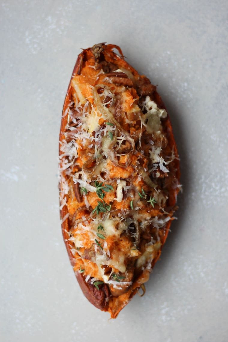 These decadent Caramelized Onion and Apple Twice Baked Sweet Potatoes is a nutritious and more flavourful take on the classic steak house staple.