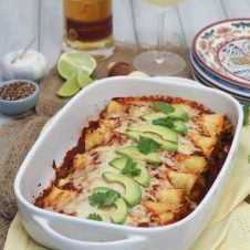 These gluten free chicken and butternut squash enchiladas are an easy, healthy family dinner that's fast, balanced and delicious every time!
