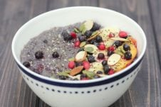 A white bowl of slow cooker blueberry quinoa.